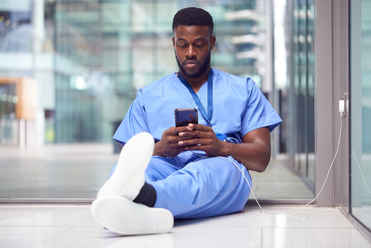 Medical worker checking messages