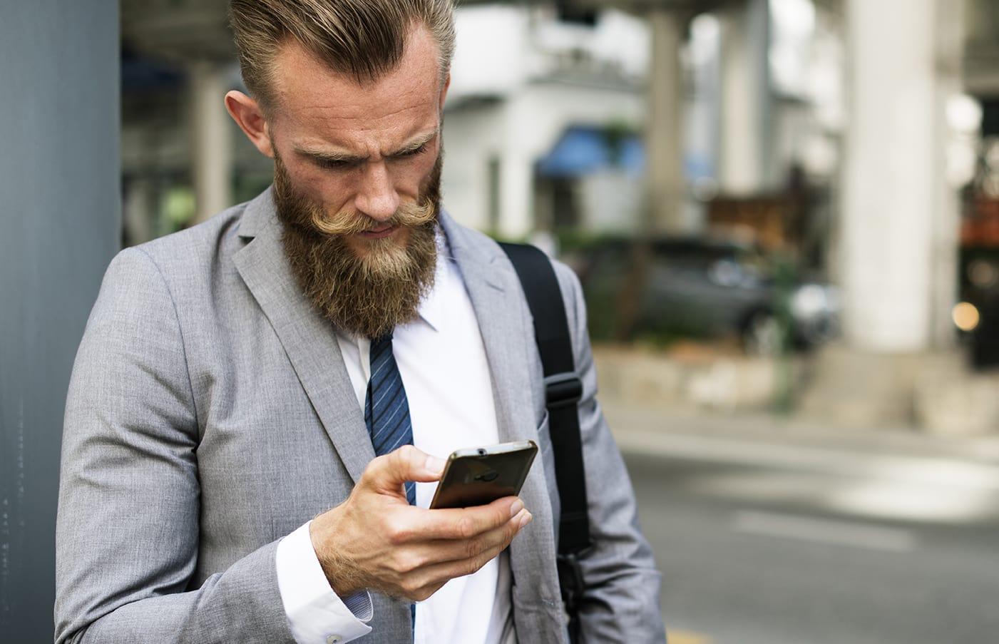 Man Checking Mobile alert
